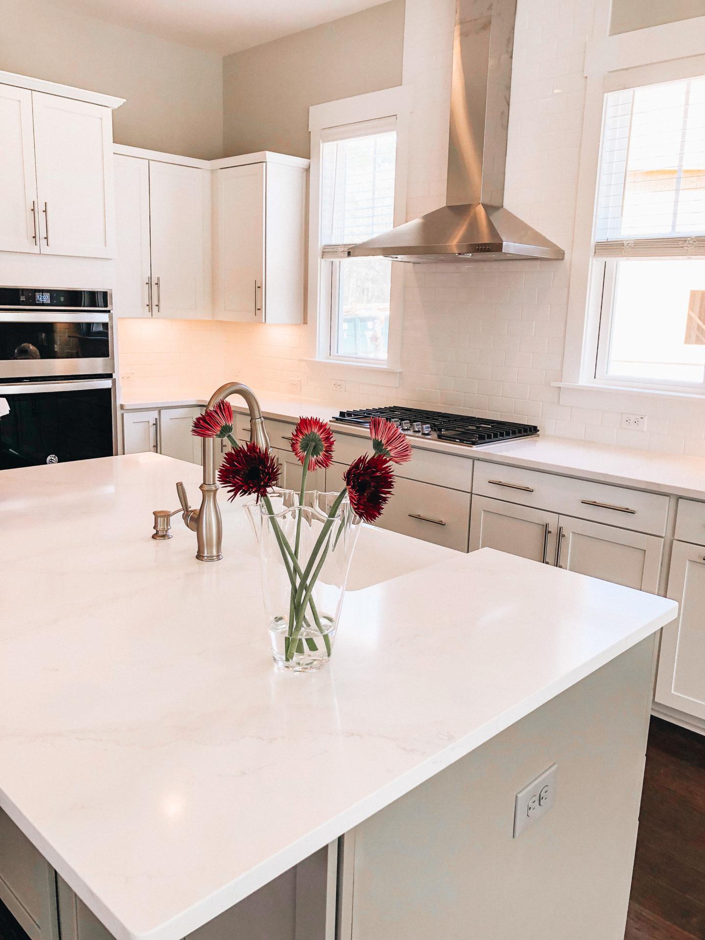 White kitchen cabinets & quartz countertops